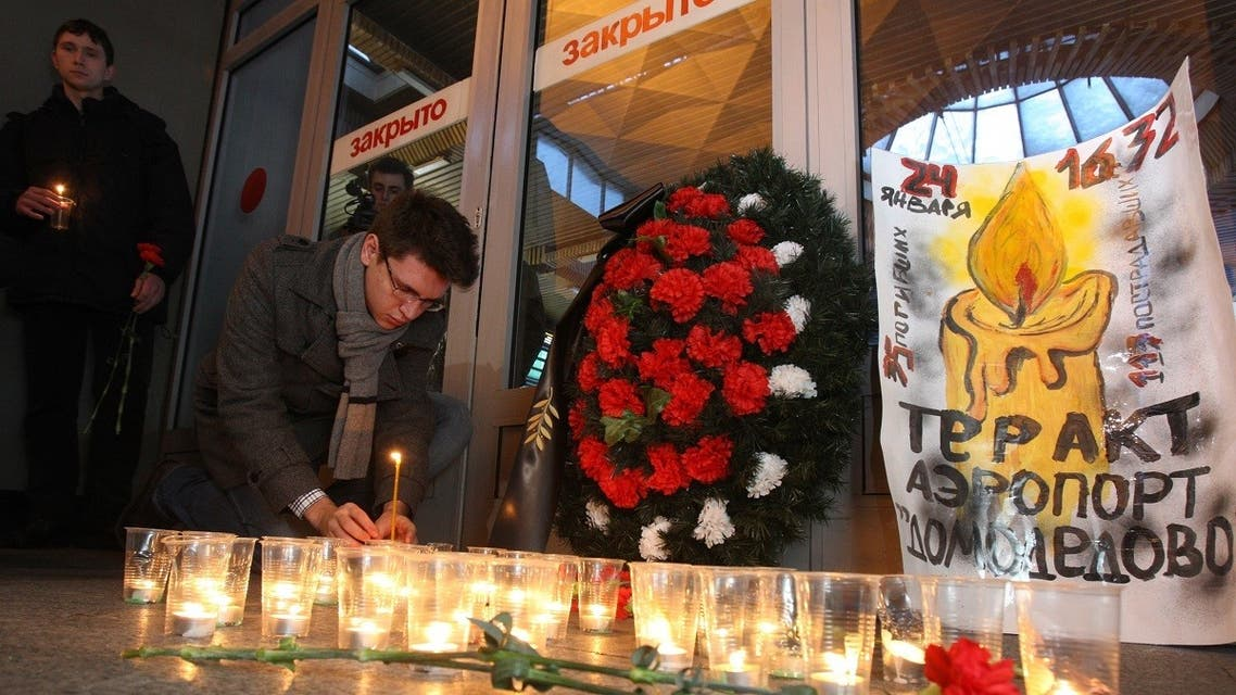 A man places a candle at a memorial inside the Moscow railway station in Saint Petersburg on January 25, 2011, the day after bomb attack at Moscow's Domodedovo airport killed 35 people. (Kirill Kudryavtsev/AFP)