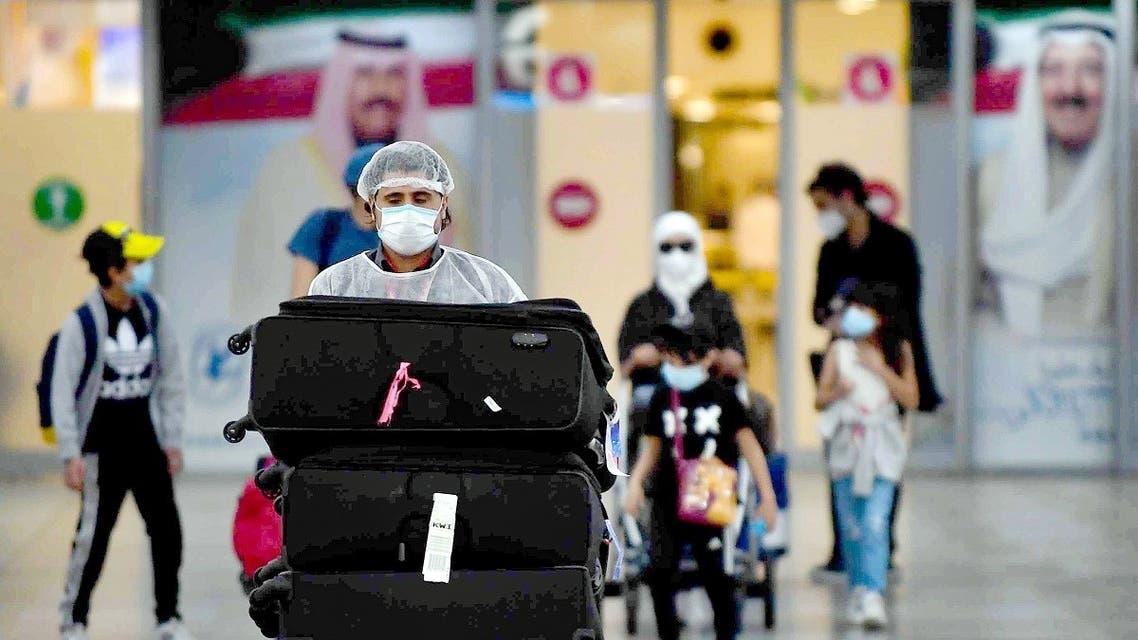 Kuwaiti nationals arrive at the Kuwait International Airport, May 3, 2020 during the novel coronavirus pandemic crisis. (Yasser aL-Zayyat/AFP)