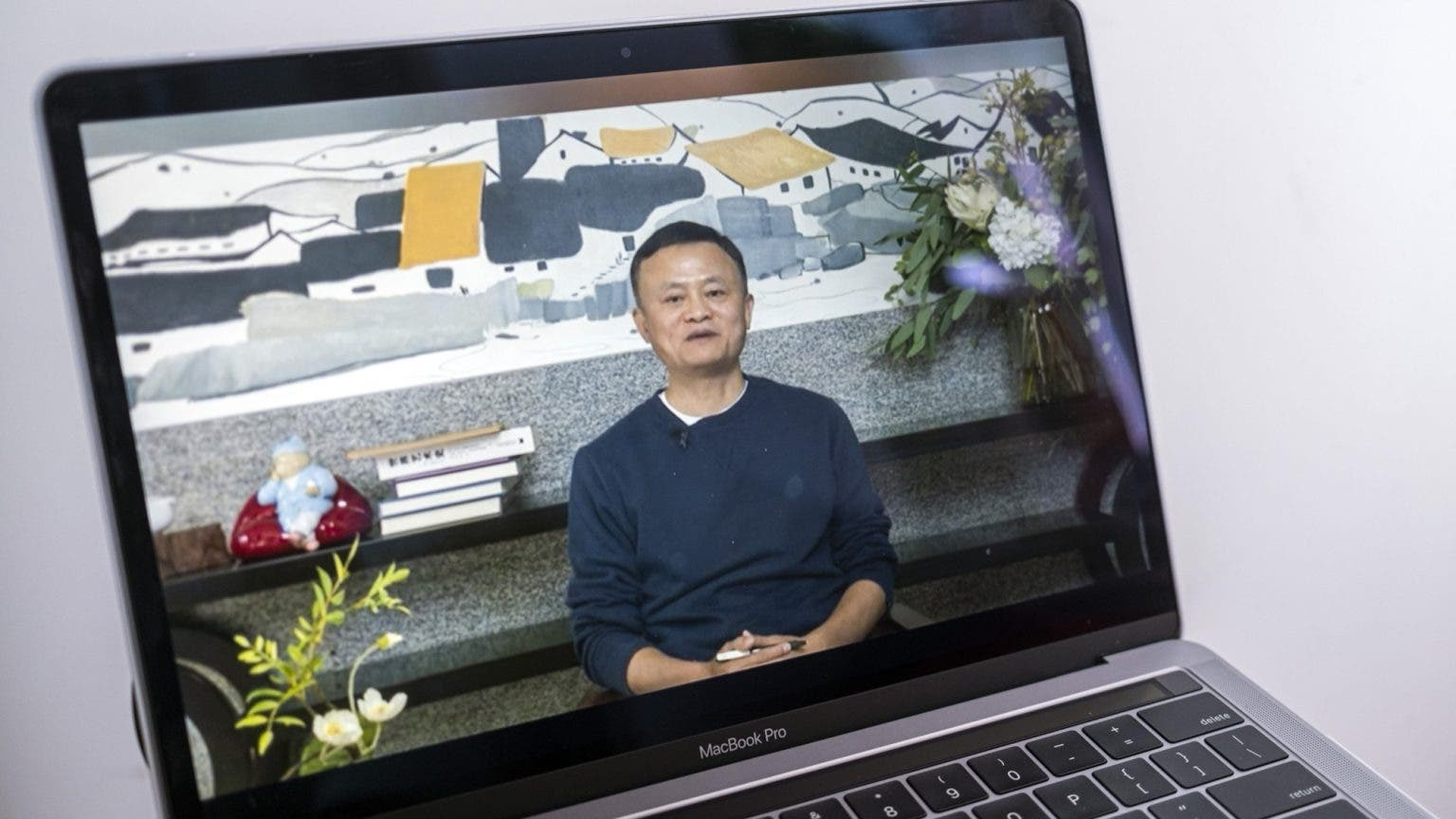 A screen shows a video of Jack Ma addressing teachers via livestream at an annual event. (Bloomberg)