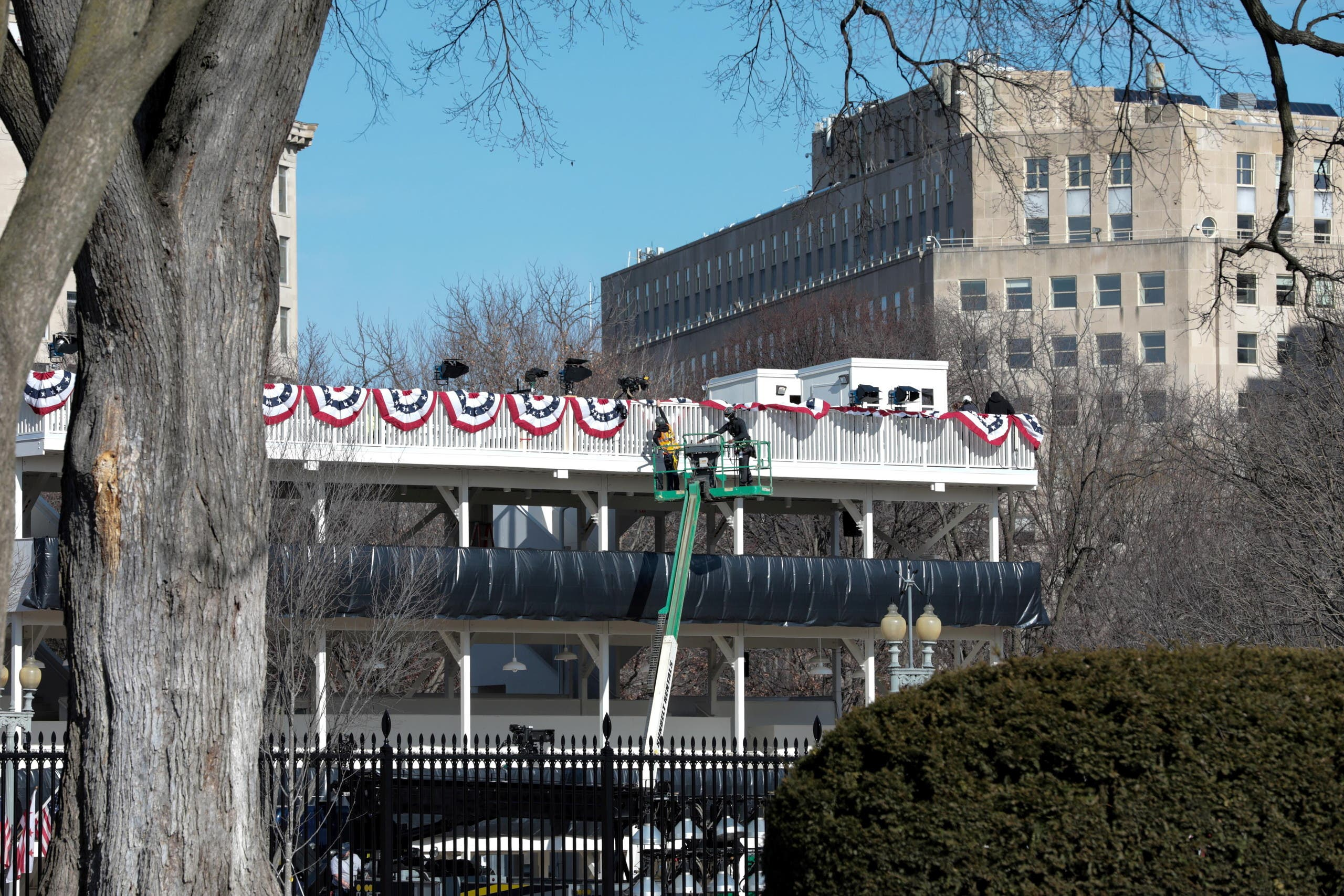 Workers make adjustments to the inaugural parade viewing stand across the front of The White House, ahead of U.S. President-elect Joe Biden's inauguration, in Washington. (reuters)
