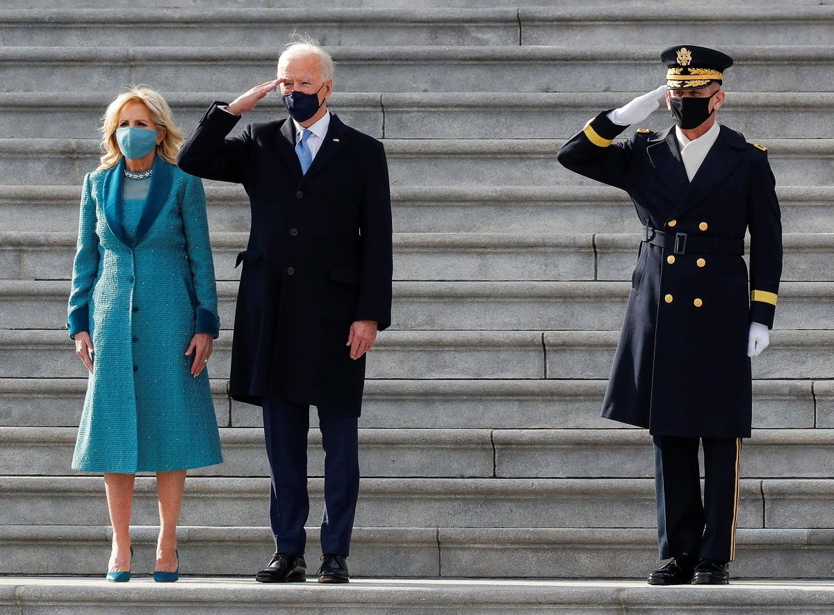 US President Joe Biden salutes next to first lady Jill Biden during the pass in review after the inauguration ceremony, in Washington, Jan. 20, 2021. (Reuters)