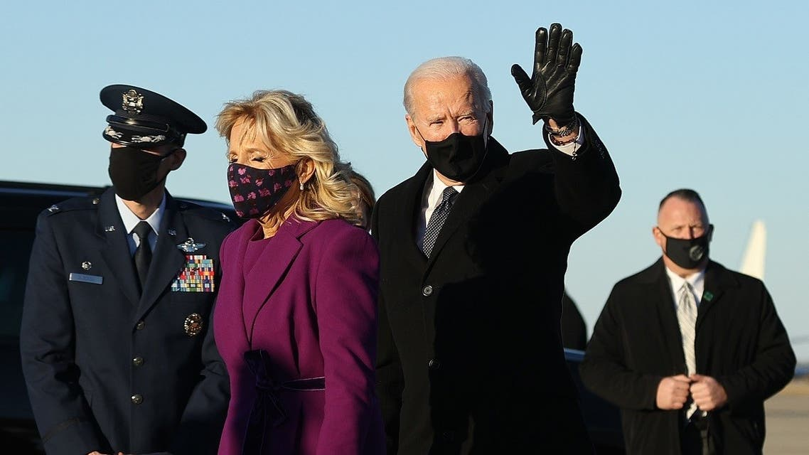President-elect Joe Biden (R) and Dr. Jill Biden arrive at Joint Base Andrews the day before he will be inaugurated as the 46th president, Jan. 19, 2021. (AFP)
