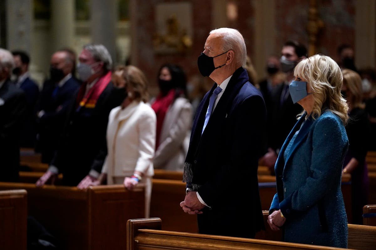 President-elect Joe Biden is joined his wife Jill Biden as they celebrate Mass at the Cathedral of St. Matthew the Apostle during Inauguration Day ceremonies, Jan. 20, 2021. (AP)