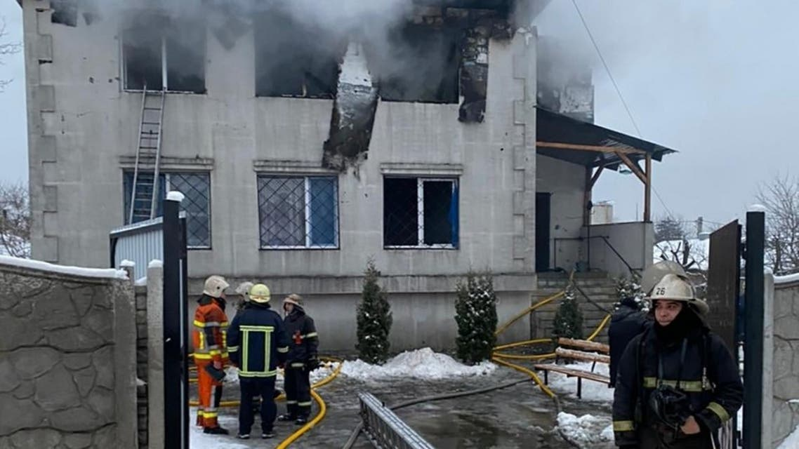 Firefighters work at the site of a fire in a nursing home in Kharkiv on January 21, 2021. (AFP)