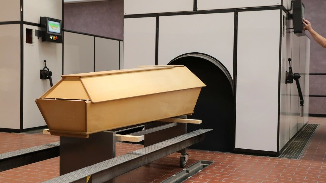202A coffin of a person who passed away stands in the furnace hall at the Crematorium Nordheim as the coronavirus outbreak continues in Zurich, Switzerland, on January 19, 2021. (Reuters)1-01-21T093046Z_1062203389_RC29CL9S058M_RTRMADP_3_HEALTH-CORONAVIRUS-SWISS-CREMATORIUM