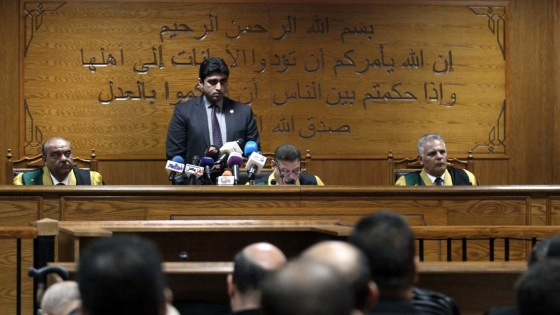 Egyptian judge Mohamed Shirin Fahmi (C) reads out a verdict and sentence as he presides over the retrial of members of the Muslim Brotherhood on charges of espionage with the Palestinian group Hamas at the Tora courthouse complex in southeastern Cairo on September 11, 2019. (AFP)