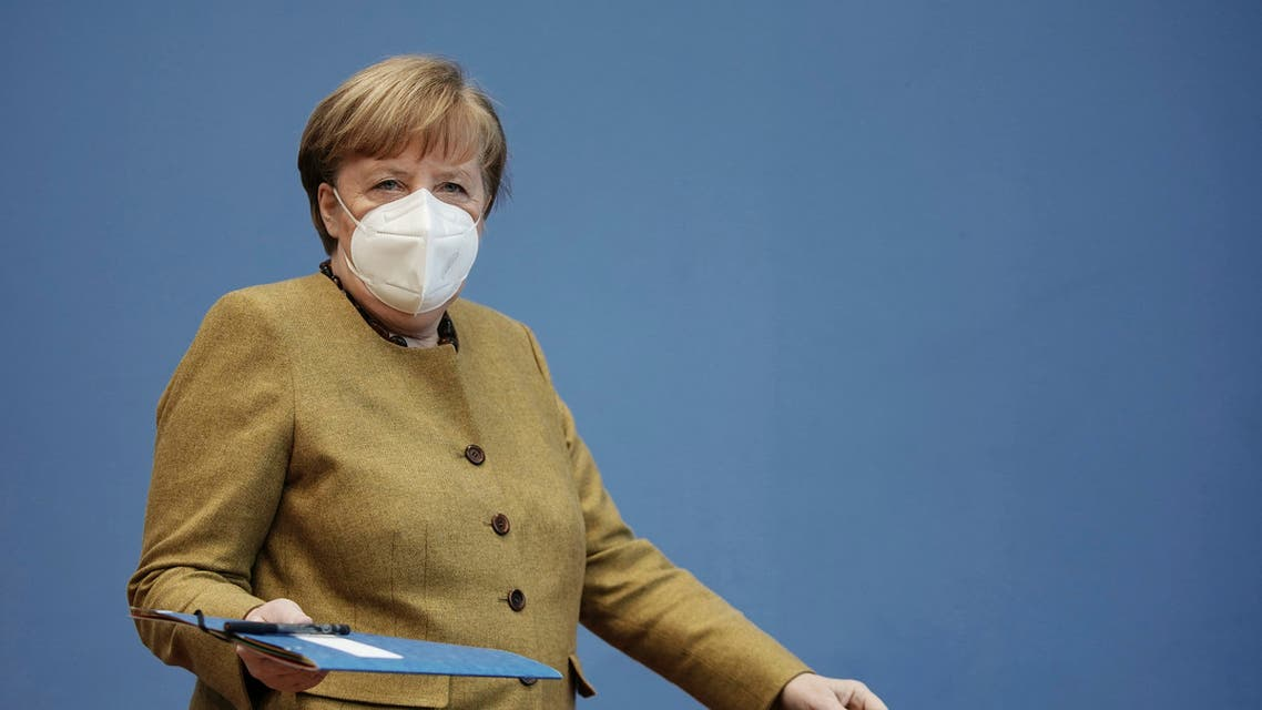 German Chancellor Angela Merkel arrives wearing a protective mask for a press conference on the current situation in Berlin, Germany, Thursday, Jan. 21, 2021.(AP)