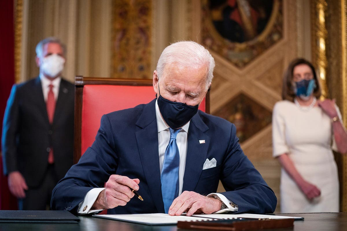 President Joe Biden signs three documents including an Inauguration declaration, cabinet nominations and sub-cabinet nominations in the Presidents Room at the Capitol, Jan. 20, 2021. (Reuters)