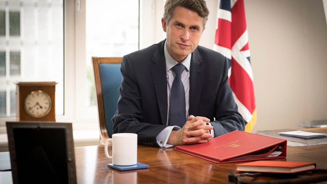 Britain's Secretary of State for Education Gavin Williamson poses for a photo in his office at the Department of Education in London. (AP)