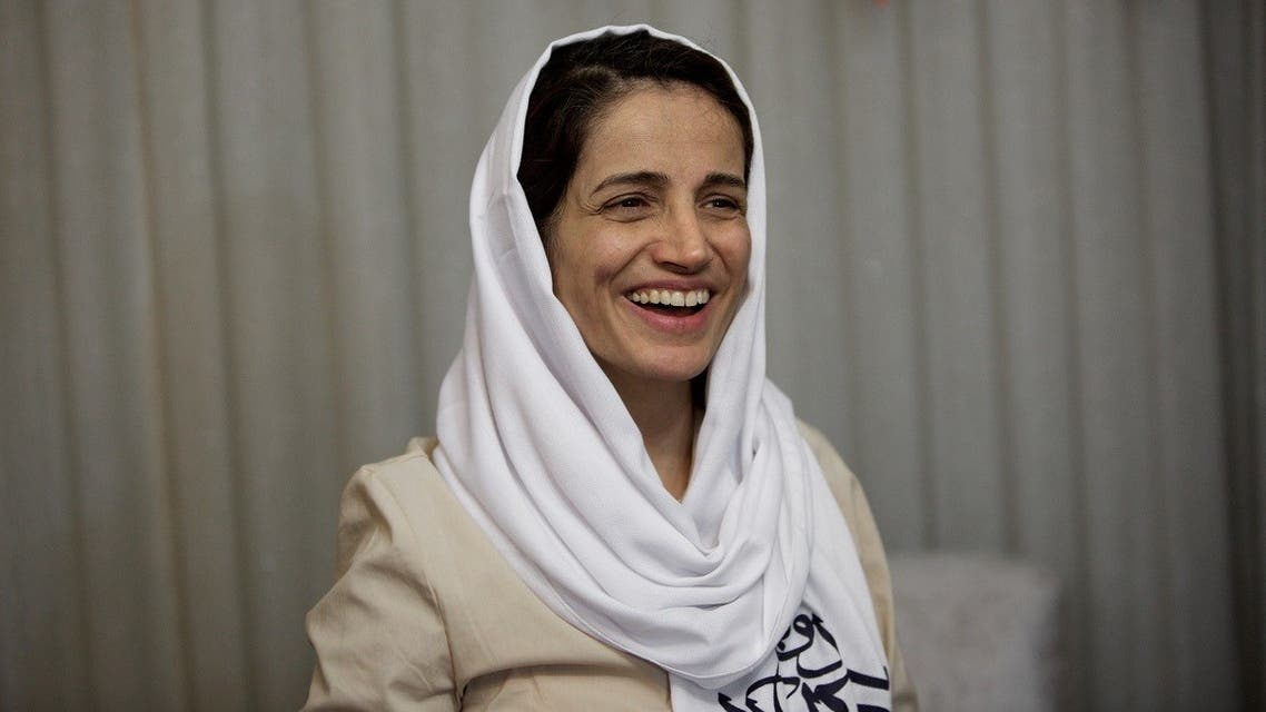 Iranian lawyer Nasrin Sotoudeh smiles at her home in Tehran on September 18, 2013, after being freed following three years in prison. (AFP)