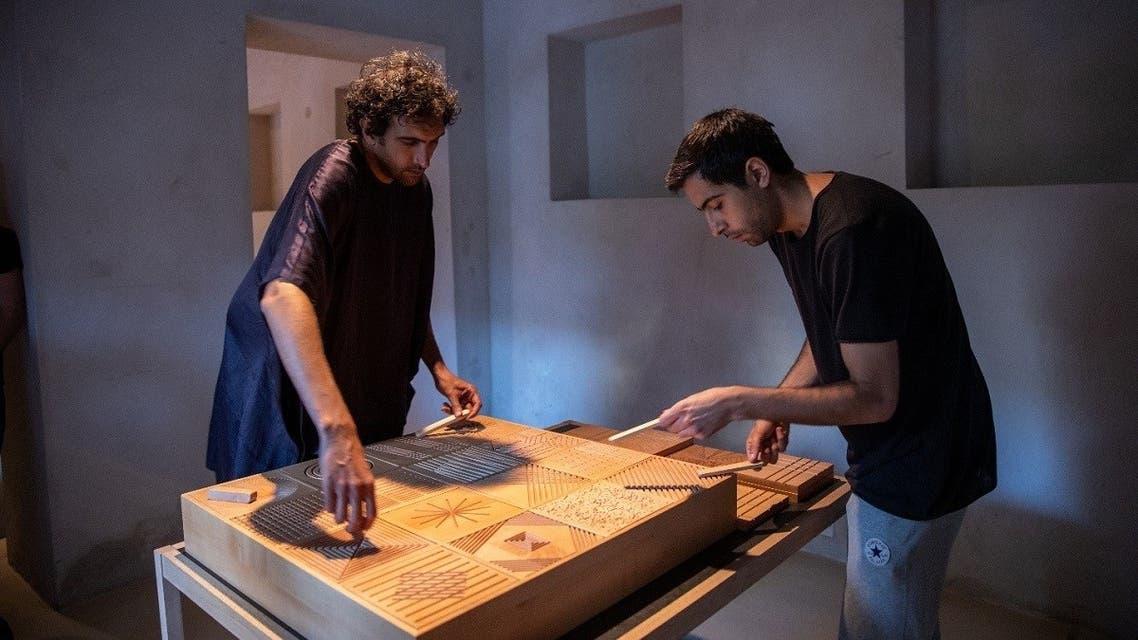 Tarek Atoui and Jad Atoui performing at the opening of 'Tarek Atoui: Cycles in 11'. (Courtesy: Sharjah Art Foundation, 2020)