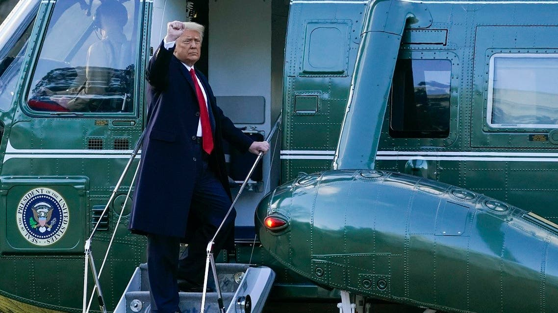 President Donald Trump gestures as he boards Marine One, Jan. 20, 2021, in Washington. (AP)