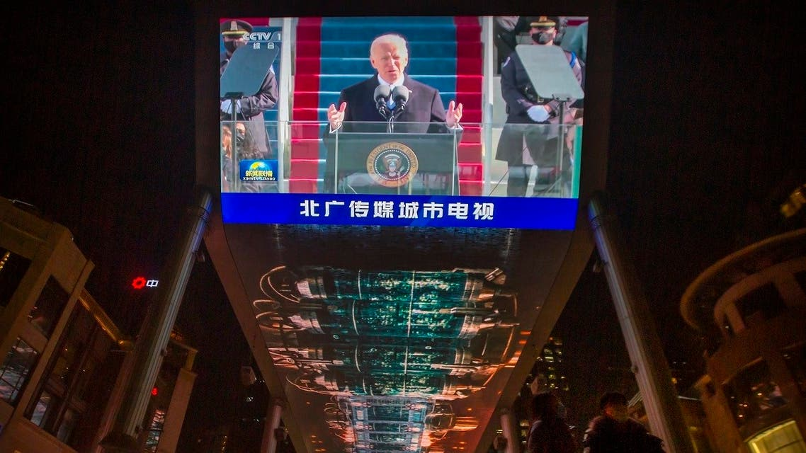 A large video shows a government news report about the inauguration of President Joe Biden at a shopping mall in Beijing, Jan. 21, 2021. (AP)