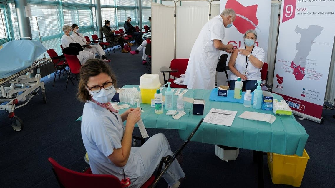 In this file photo taken on January 8, 2021 a medical staff receives the Pfizer-BioNTech Covid-19 vaccine at the Emile Muller hospital in Mulhouse, eastern France. (Sebastien Bozon/AFP)