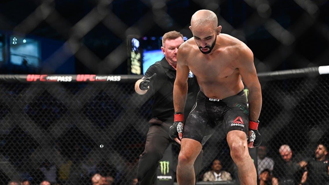 A file photo shows Ottman Azaitar (red gloves) fights Teemu Packalen (blue gloves) during UFC 242 at The Arena, Abu Dhabi, UAE. (Per Haljestam-USA TODAY Sports via Reuters)