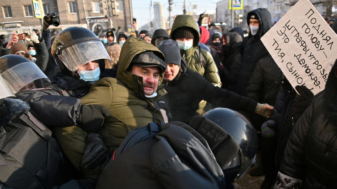 Law enforcement officers restrain a protester during a rally in support of jailed Russian opposition leader Alexei Navalny in Omsk, Russia January 23, 2021. (Reuters)
