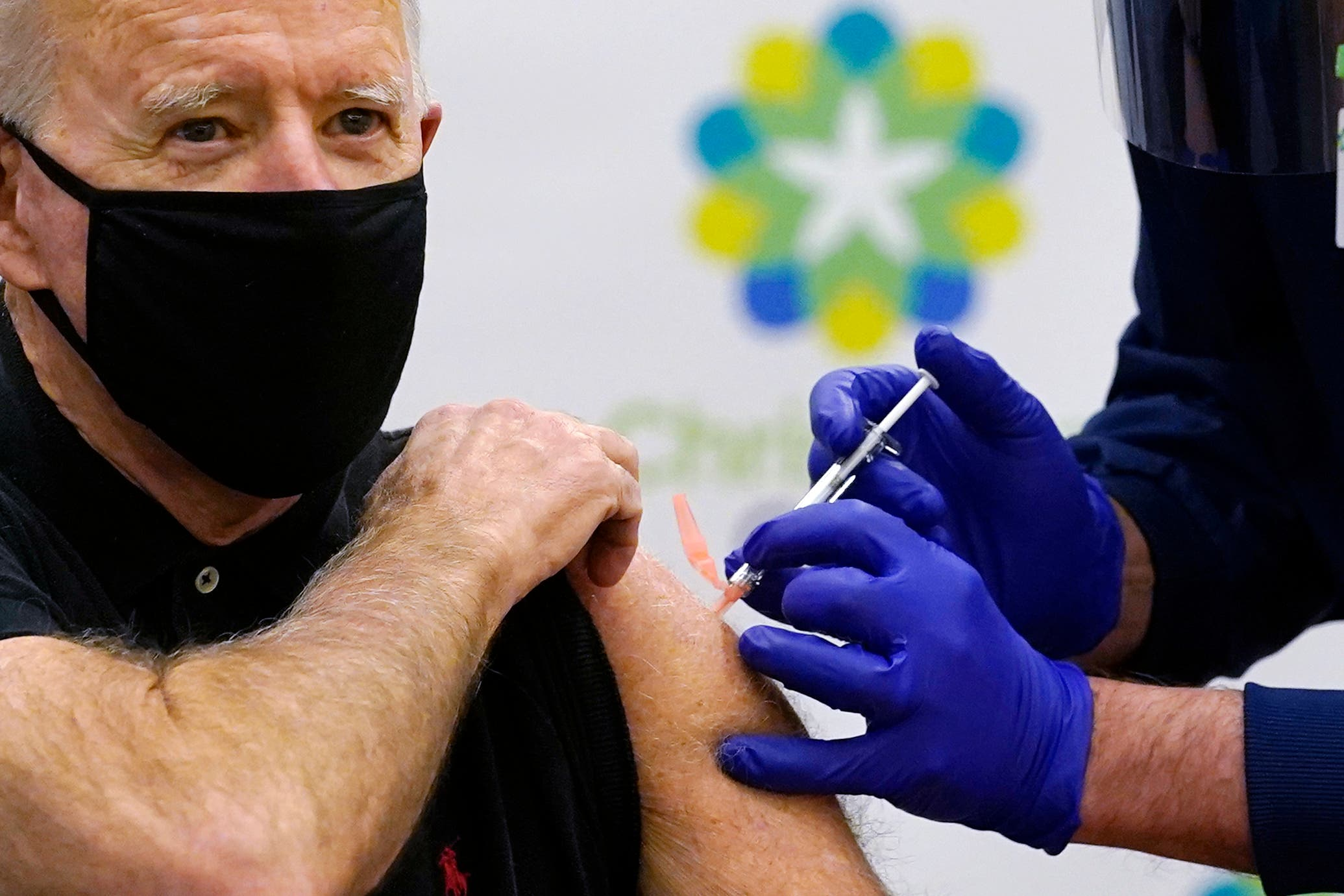 President-elect Joe Biden receives his second dose of the coronavirus vaccine at ChristianaCare Christiana Hospital in Newark, Del., Monday, Jan. 11, 2021. The vaccine is being administered by Chief Nurse Executive Ric Cuming. (AP)