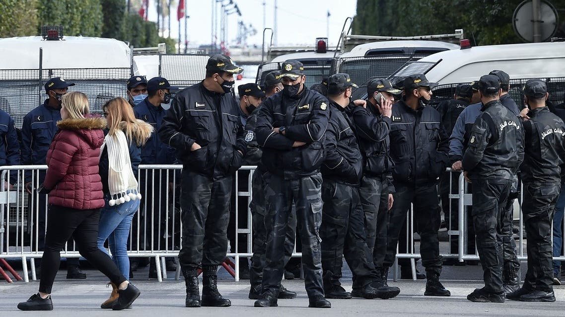Members of the Tunisian police block the Habib Bourguiba Avenue during an anti-government demonstration in the capital Tunis, on January 23, 2021. (Fethi Belaid/AFP)