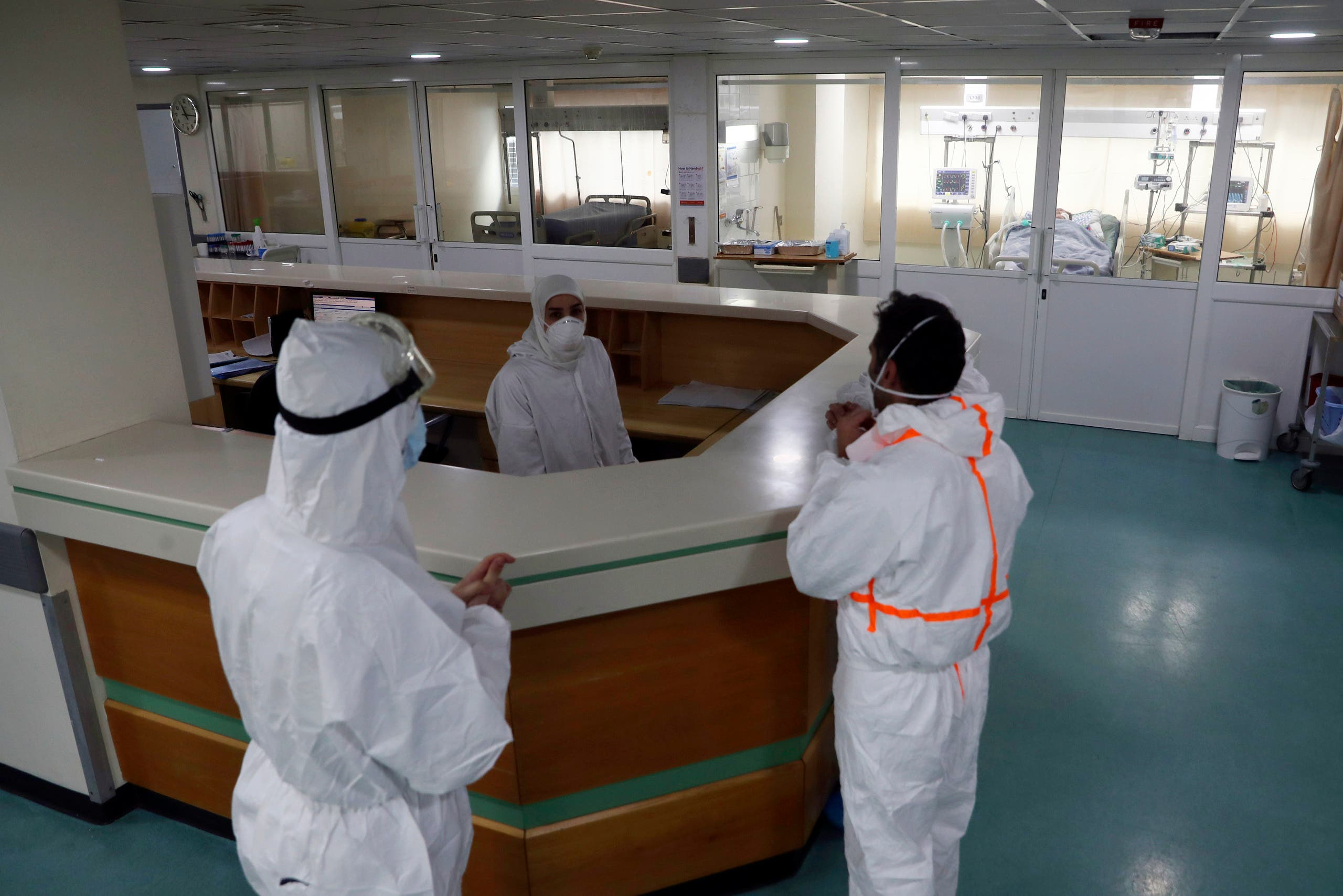 Medical staff stand at the intensive care unit of the Rafik Hariri University Hospital in Beirut, Lebanon. (AP)