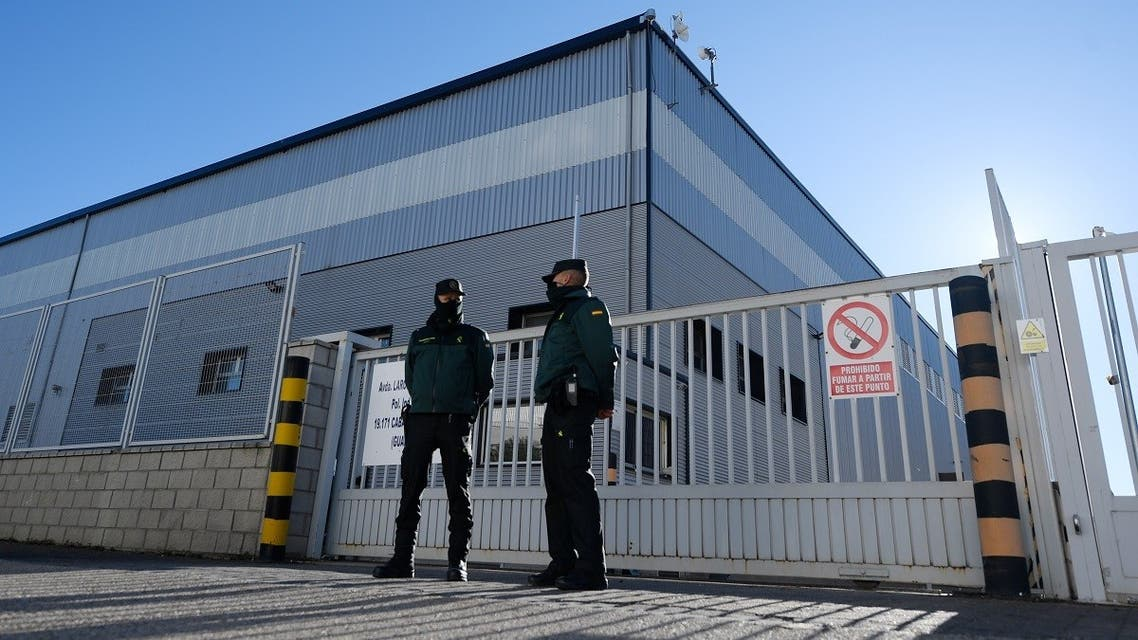 Civil guards watch the entrance of a warehouse in Cabanillas del Campo, Guadalajara province, where the first batch of the Pfizer-BioNTech vaccine is stored after arriving from Belgium, December 26, 2020. (Oscar Del Pozo/AFP)