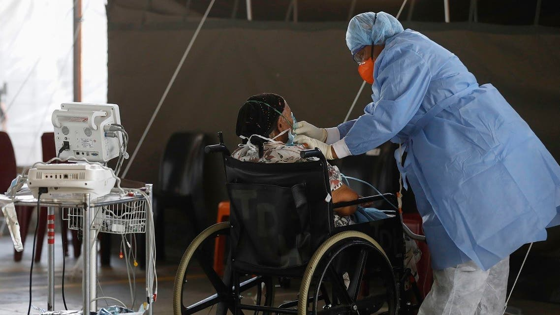 A healthcare worker provides oxygen to a patient at the Steve Biko Academic Hospital in South Africa, Jan. 19, 2021. (AP)