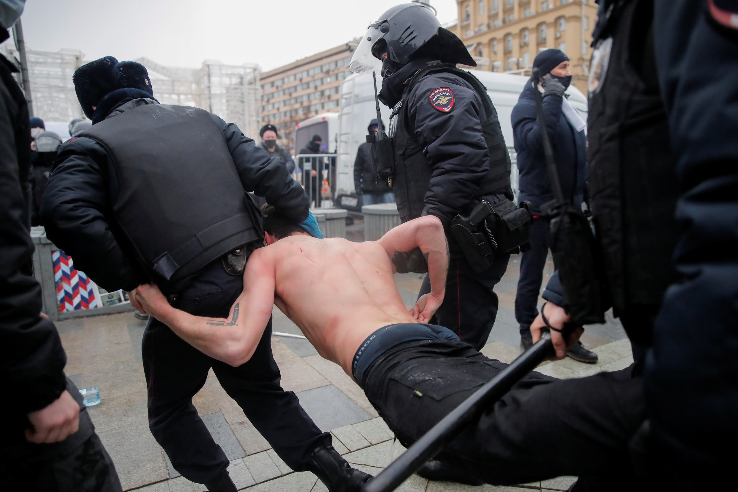 Law enforcement officers detain a man during a rally in support of jailed Russian opposition leader Alexei Navalny in Moscow, Russia January 23, 2021. (Reuters)