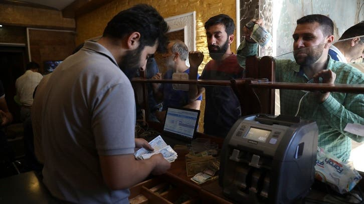 Syrian pound sinks to record low with 3,450 against dollar