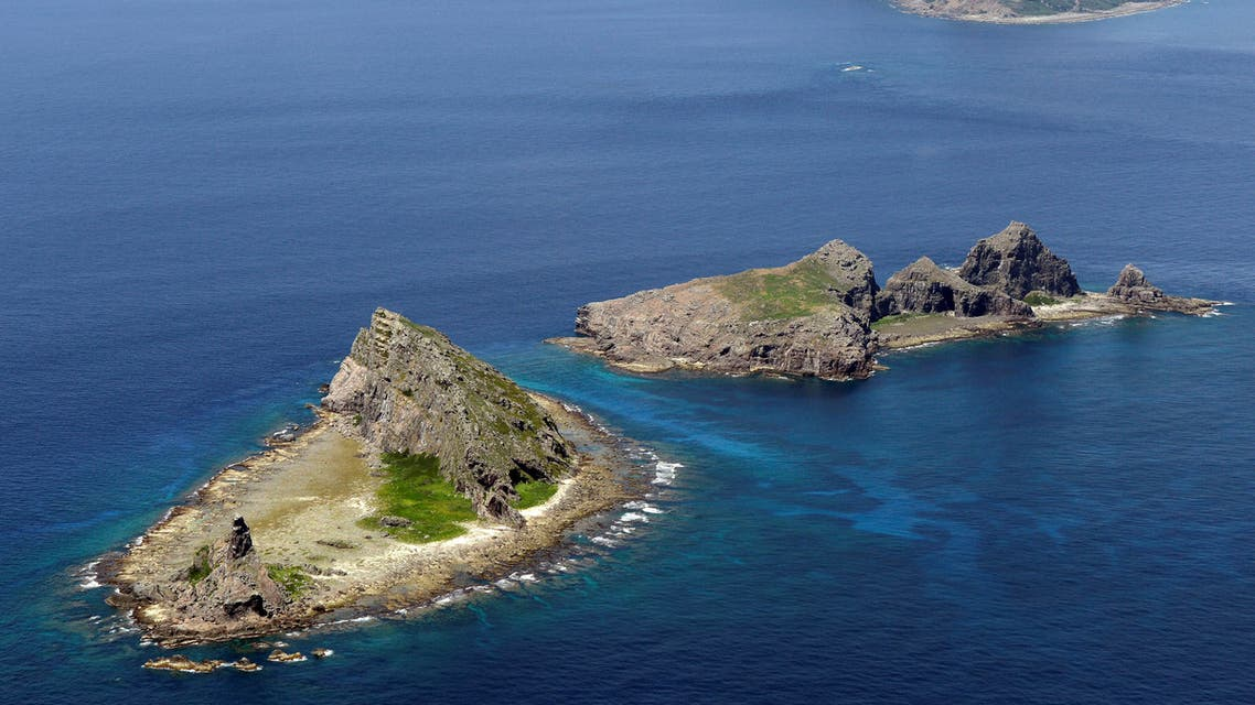 A group of disputed islands, Uotsuri island (top), Minamikojima (bottom) and Kitakojima, known as Senkaku in Japan and Diaoyu in China is seen in the East China Sea, in this photo taken by Kyodo September 2012. Mandatory credit. REUTERS/Kyodo/File Photo