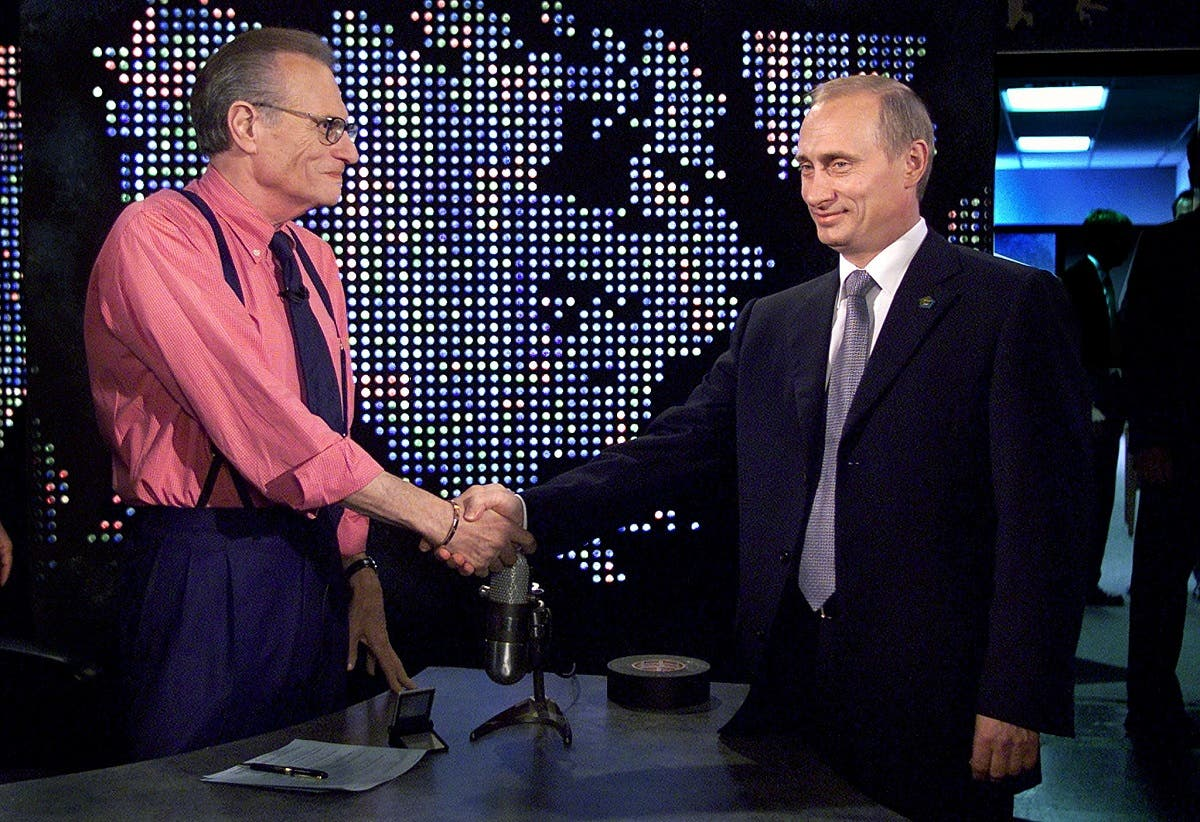 Russian President Vladimir Putin shakes hands with Larry King before a taping of The Larry King Show in New York, U.S, September 8, 2000. (Reuters)
