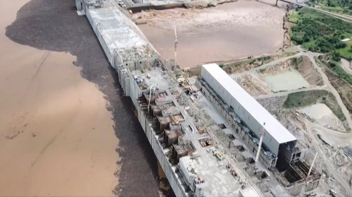 This frame grab from a video obtained from the Ethiopian Public Broadcaster (EBC) on July 20 and July 21, 2020 and released on July 24, 2020 shows water pouring out of the Renaissance Dam in Guba, Ethiopia, as Prime Minister Abiy Ahmed hails the historic early filling of the reservoir on the Blue Nile River that has stoked tensions with downstream neighbours Egypt and Sudan.