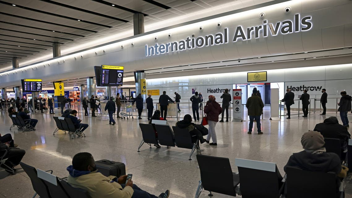 People wait at the arrivals area, as tighter rules for international travellers start, at terminal 2 of the Heathrow Airport, amid the spread of the coronavirus disease (COVID-19) pandemic, London, Britain, January 18, 2021. (Reuters)
