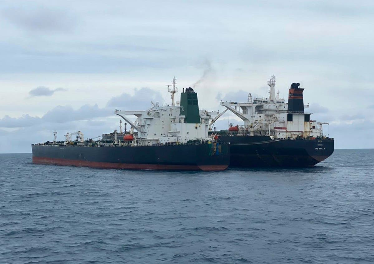 Iranian-flagged MT Horse, left, and Panamanian-flagged MT Frea tankers are seen anchored together in Pontianak waters off Borneo island, Indonesia, Sunday, Jan. 24, 2021. (Indonesian Maritime Security Agency via AP)