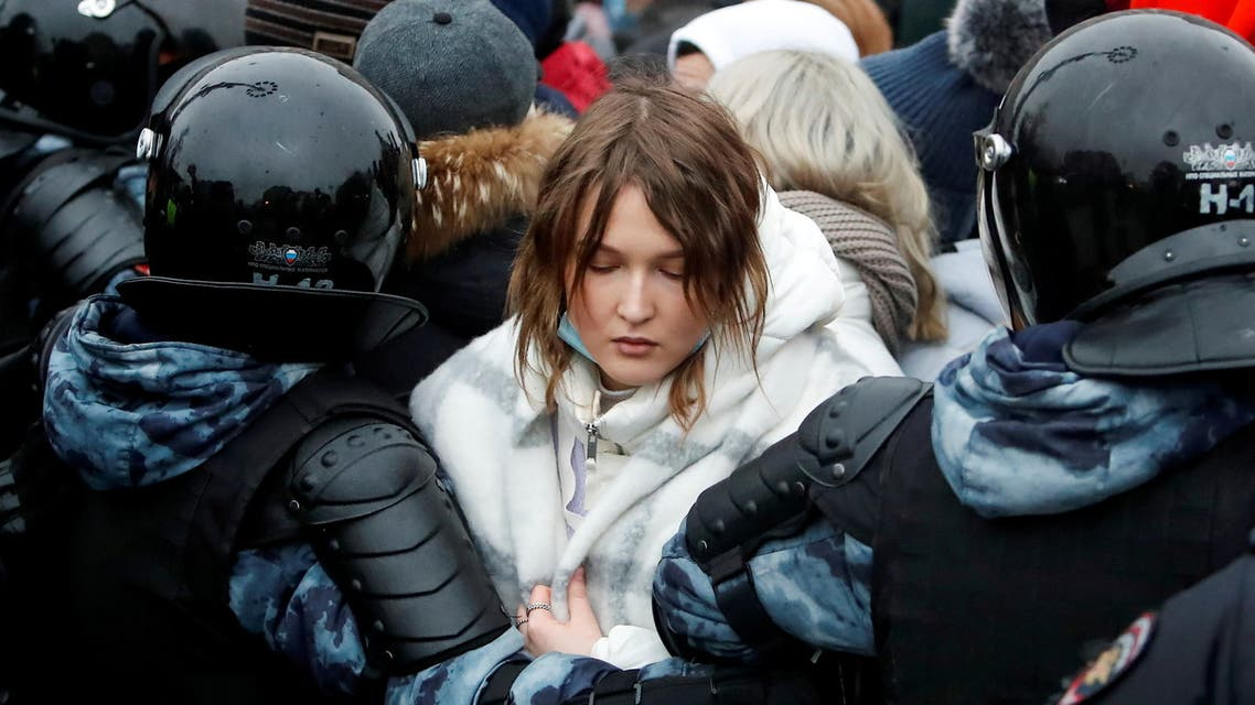 Law enforcement officers detain a woman during a rally in support of jailed Russian opposition leader Alexei Navalny in Moscow, Russia January 23, 2021. REUTERS/Maxim Shemetov TPX IMAGES OF THE DAY