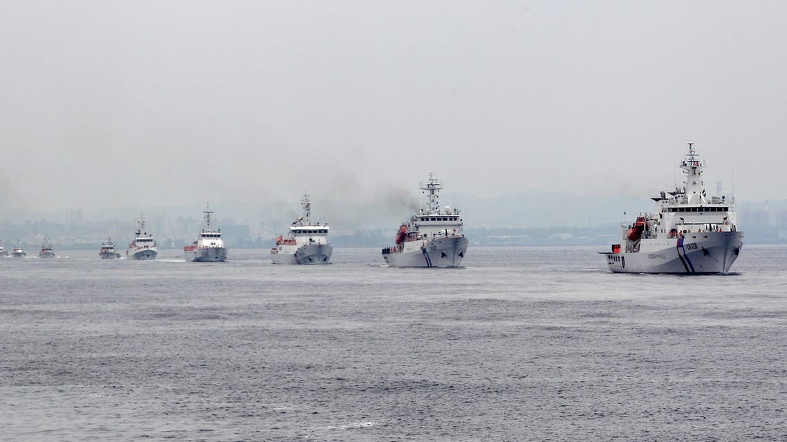 Taiwan Coast Guard patrol ships are seen during a drill held about 4 nautical miles out of the port of Kaohsiung, southern Taiwan, June 6, 2015. Taiwan's coast guard on Saturday commissioned its biggest ships for duty, in the form of two 3,000-ton patrol vessels, as Taipei boosts its defences amid concerns about China's growing footprint in the disputed South China Sea. REUTERS/Pichi Chuang