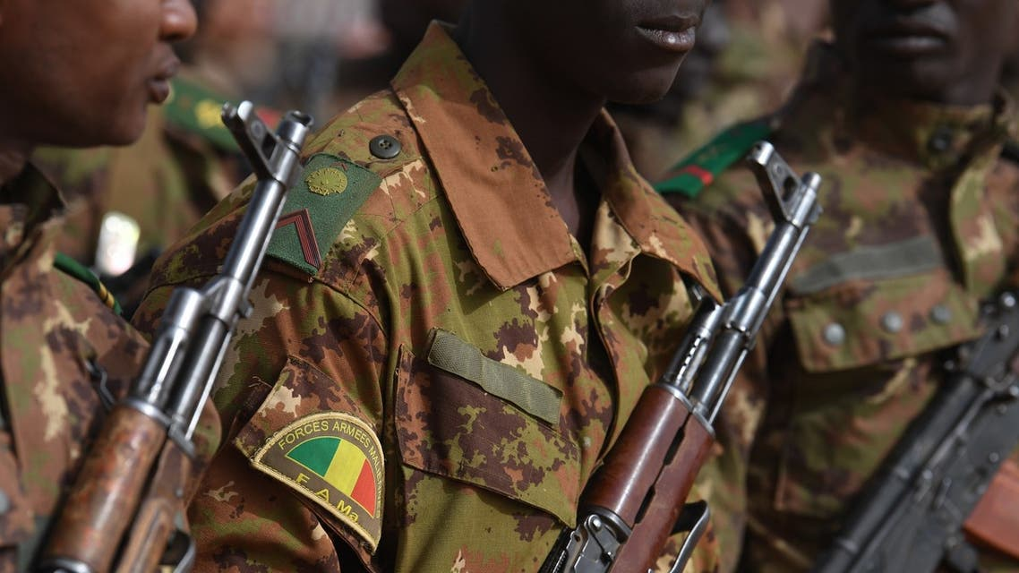 Malian troops stand guard prior to the visit of the French Prime Minister at the Operation Barkane military French base in Gao, Mali, on February 24, 2019.