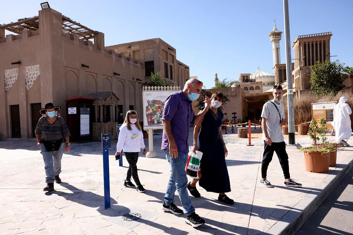Israeli tourists, mask-clad due to coronavirus, visit al-Fahidi Historical Neighborhood of Dubai on January 11, 2021. (Karim Sahib/AFP)