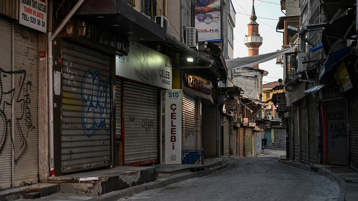 In this photo taken on December 6, 2020 a deserted street with shops closed can be seen near Eminonu square in Istanbul during a week-end curfew aimed at curbing the spread of the Covid-19 pandemic caused by the novel coronavirus. Under the new restrictions beginning from December 1, a curfew will be imposed on weekdays from 9:00 pm. to 5:00 am. Over the weekend the lockdown will last from 9:00 pm Friday until 5:00 am on Monday.