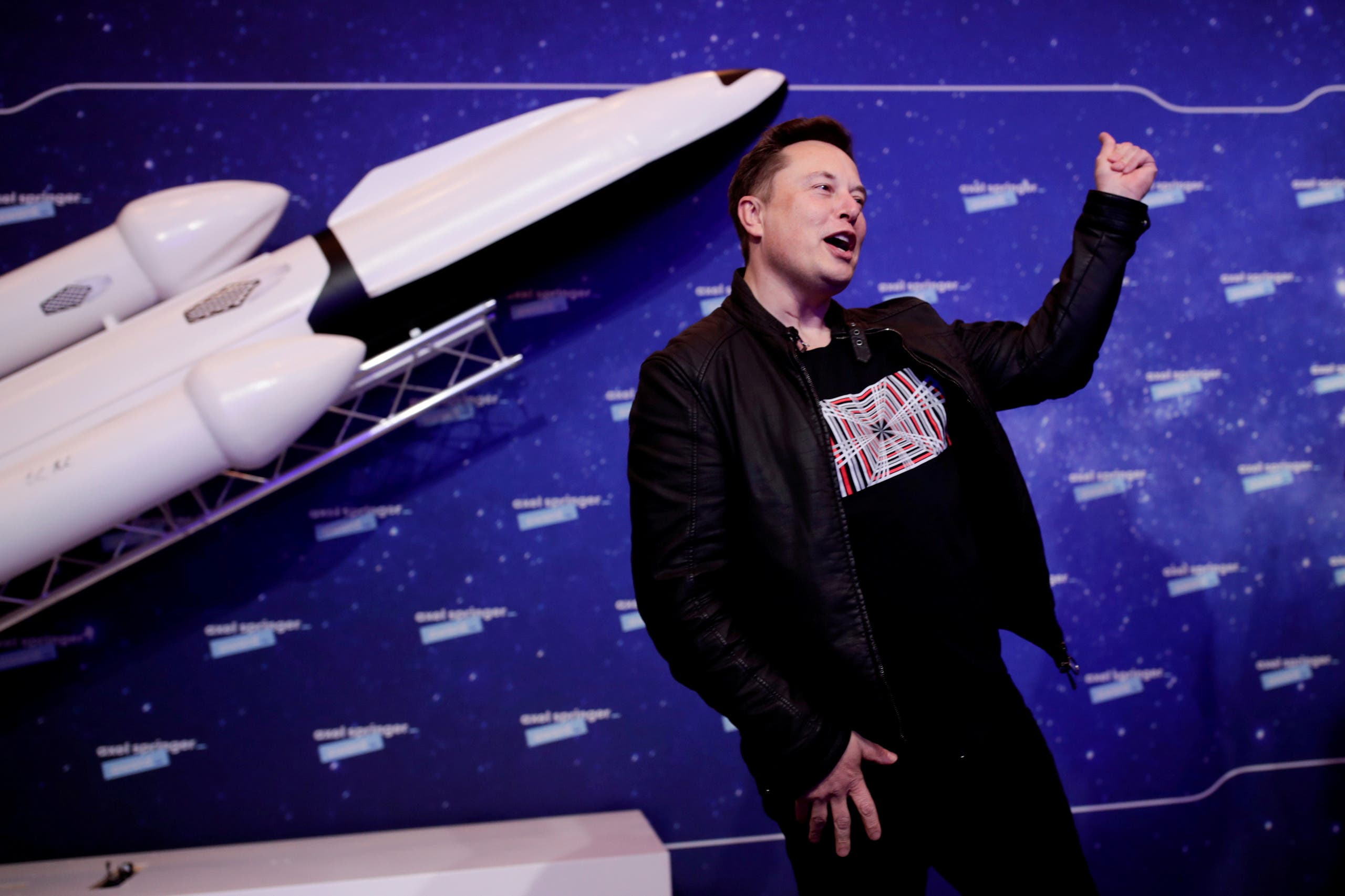 SpaceX owner and Tesla CEO Elon Musk gestures after arriving on the red carpet for the Axel Springer award, in Berlin, Germany, December 1, 2020. (Reuters)