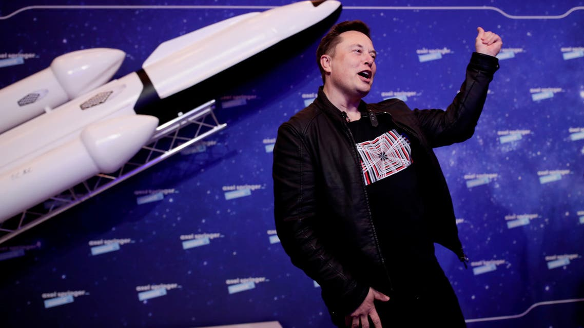 FILE PHOTO: SpaceX owner and Tesla CEO Elon Musk gestures after arriving on the red carpet for the Axel Springer award, in Berlin, Germany, December 1, 2020. REUTERS/Hannibal Hanschke/File Photo