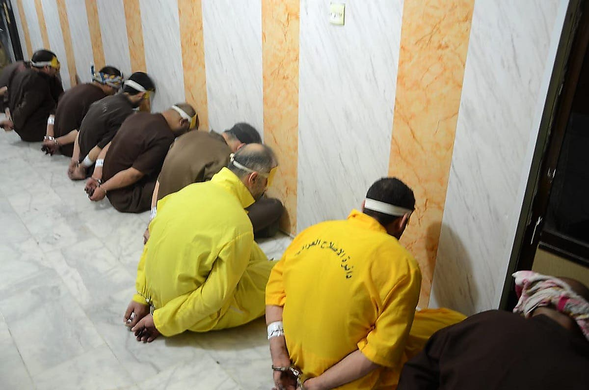 This handout file picture released by the Iraqi Justice Ministry on June 29, 2018 shows blindfolded and handcuffed extremists of ISIS who have been condemned to death waiting for their sentences to be executed. (Iraq Justice Minister/AFP)