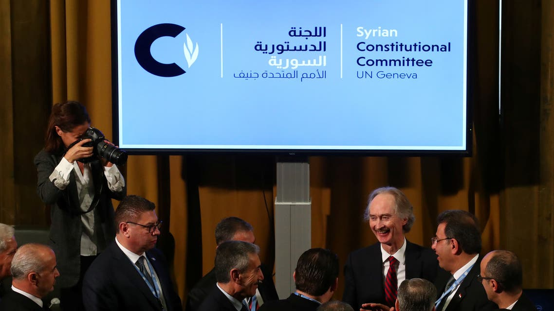 U.N. Special Envoy for Syria Geir Pedersen talks with Ahmad Kuzbari, co-chair for the Syrian Government, and other members ot their delegation after the first meeting of the new Syrian Constitutional Committee at the United Nations in Geneva, Switzerland, October 30, 2019. REUTERS/Denis Balibouse