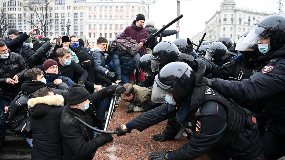 Protesters clash with riot police during a rally in support of jailed opposition leader Alexei Navalny in downtown Moscow on January 23, 2021. Navalny, 44, was detained last Sunday upon returning to Moscow after five months in Germany recovering from a near-fatal poisoning with a nerve agent and later jailed for 30 days while awaiting trial for violating a suspended sentence he was handed in 2014.