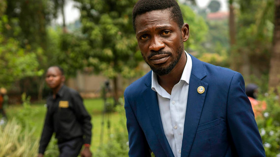Uganda's leading opposition challenger Bobi Wine walks back to his residence after giving a press conference outside Kampala, Uganda. (File photo: AP)