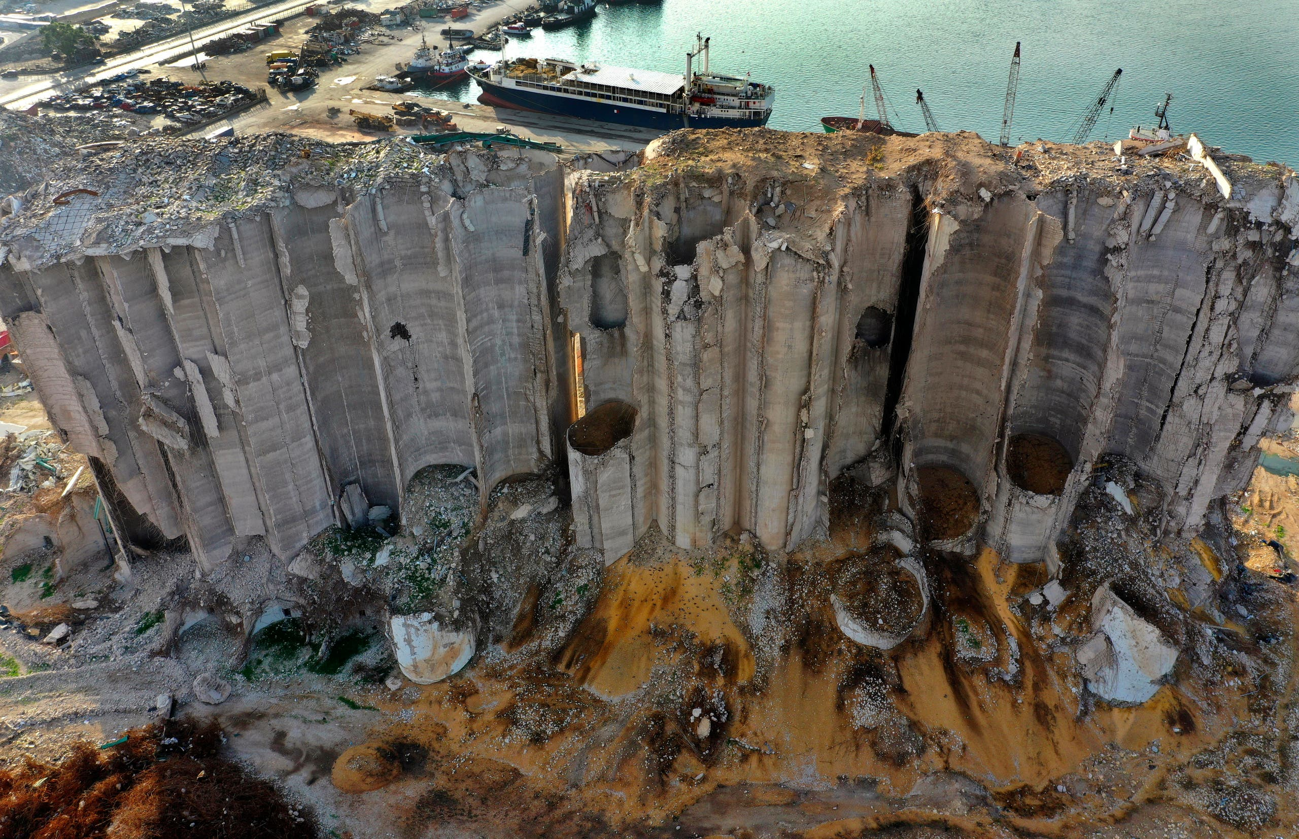 Rubble, spilled grains remain around towering silos gutted in the massive August explosion at the Beirut port that claimed the lives of more than 200 people, in Beirut, Lebanon. (AP)