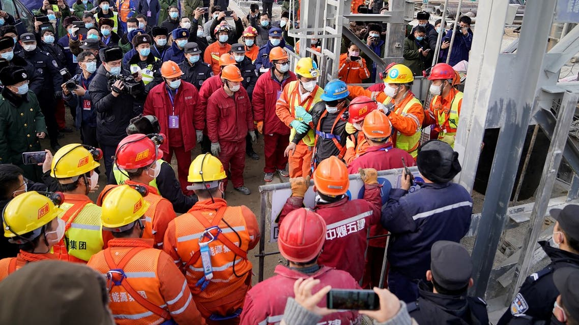 One of twenty-two Chinese miners is saved from hundreds of metres underground where they had been trapped for two weeks after a gold mine explosion in Qixia, in eastern China's Shandong province on January 24, 2021.
