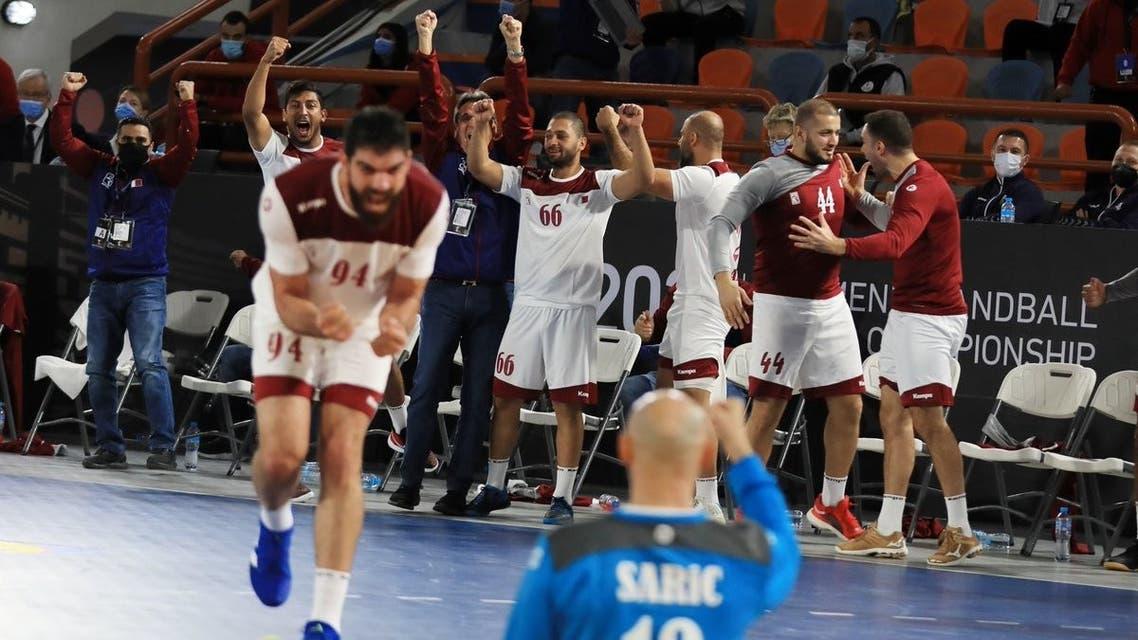 Qatar's handball team celebrates their victory against Argentina, securing a quarter-final place. (Qatar Handball via Twitter)