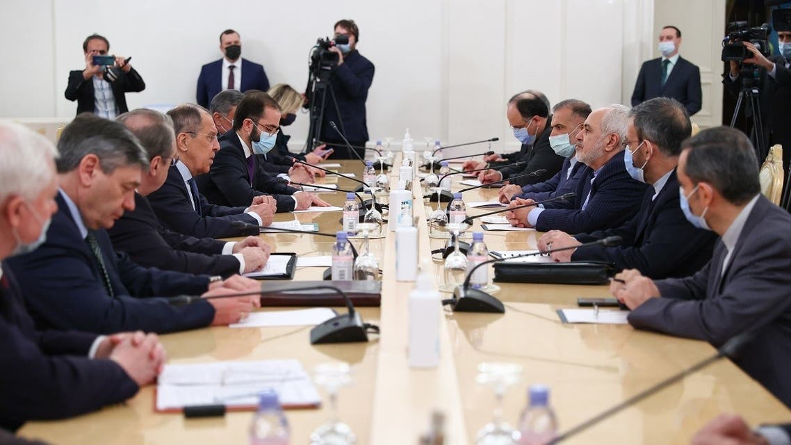 Russian Foreign Minister Sergei Lavrov meets with his Iranian counterpart Mohammad Javad Zarif in Moscow on January 26, 2021. (Russian Foreign Ministry/AFP)
