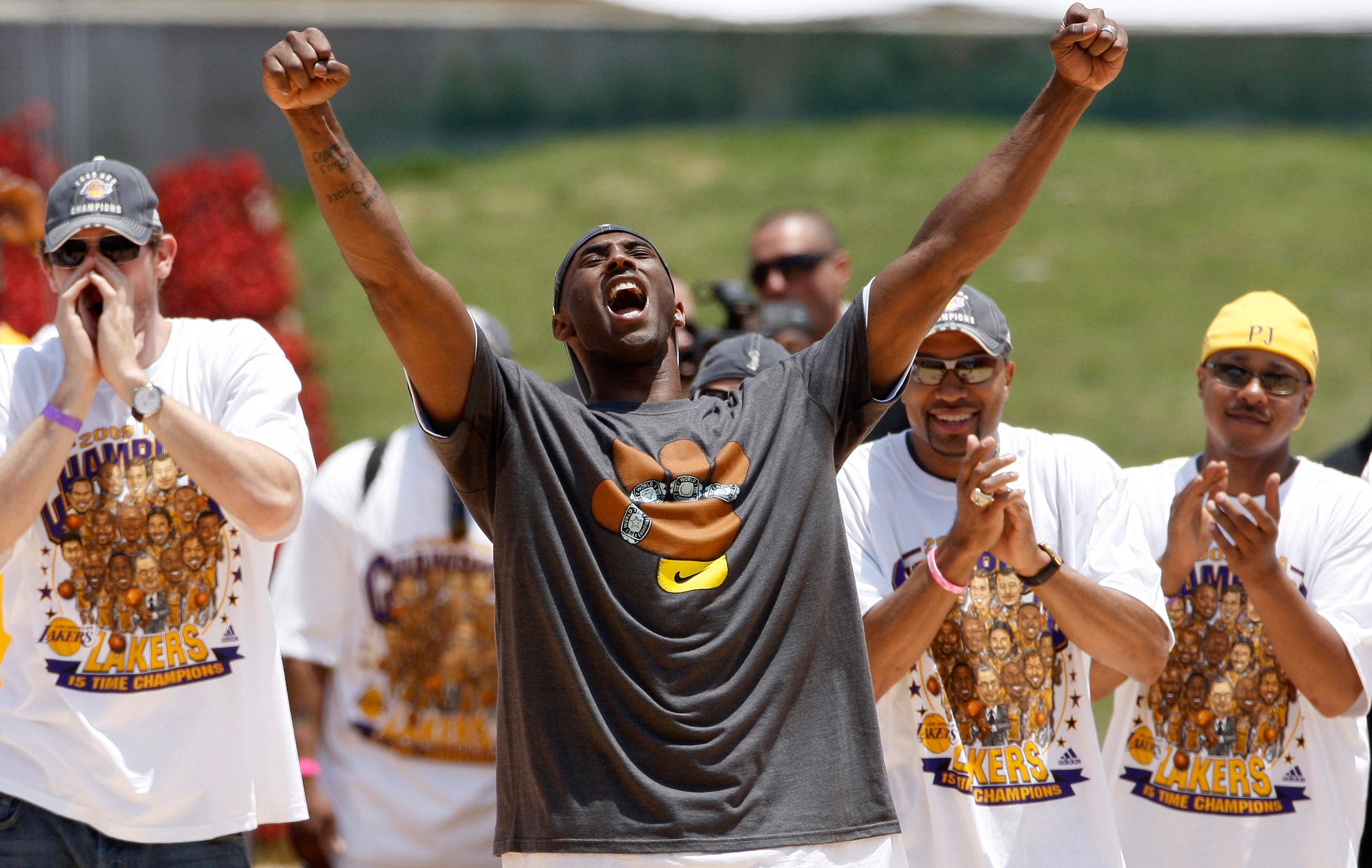 Kobe Bryant celebrates while on stage during the Lakers' NBA championship victory rally at the Los Angeles Memorial Coliseum in Los Angeles on Wednesday, June 17, 2009. (AP)
