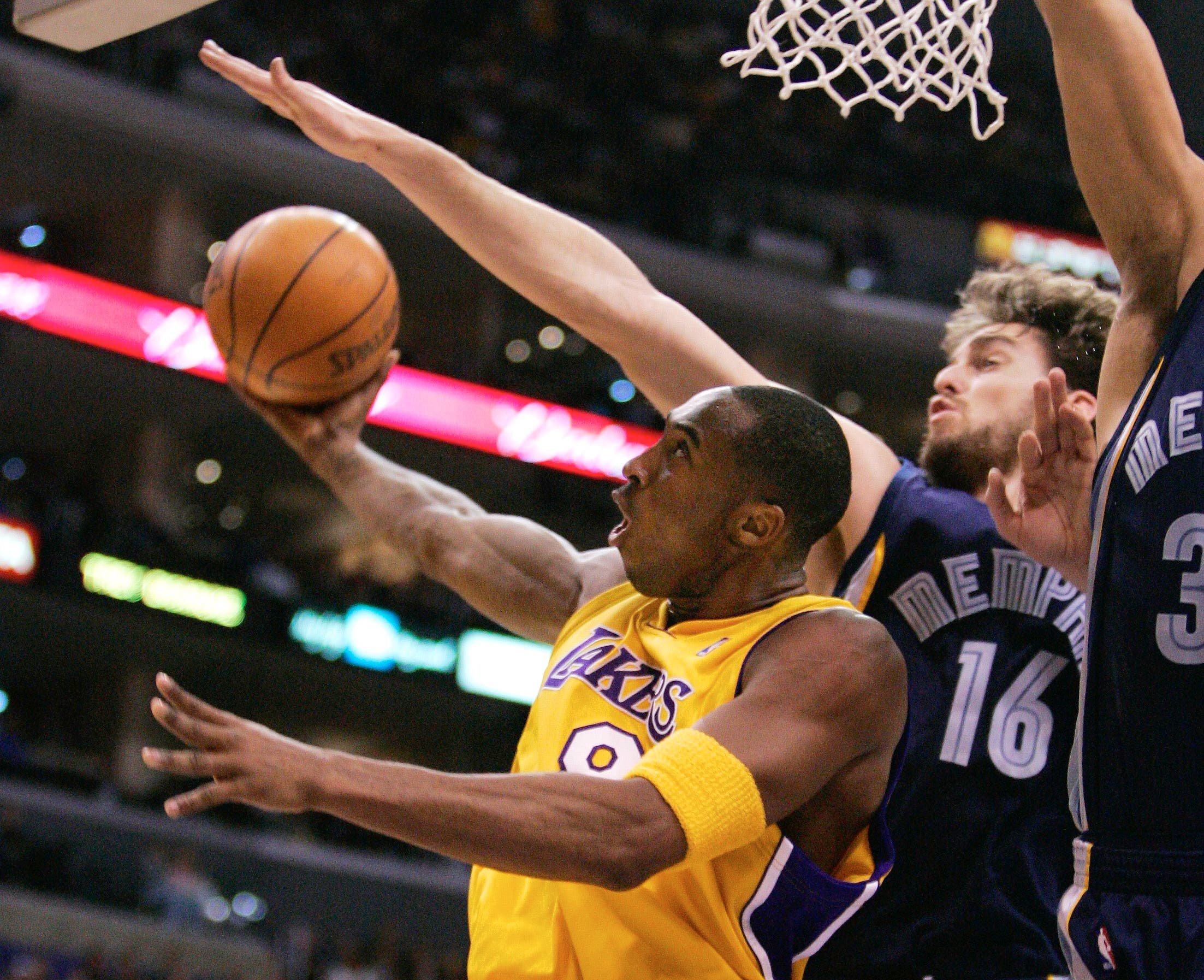 Kobe Bryant puts up a shot around Memphis Grizzlies' Pau Gasol, of Spain, during the first half of an NBA basketball game Wednesday, Dec. 28, 2005. (AP)