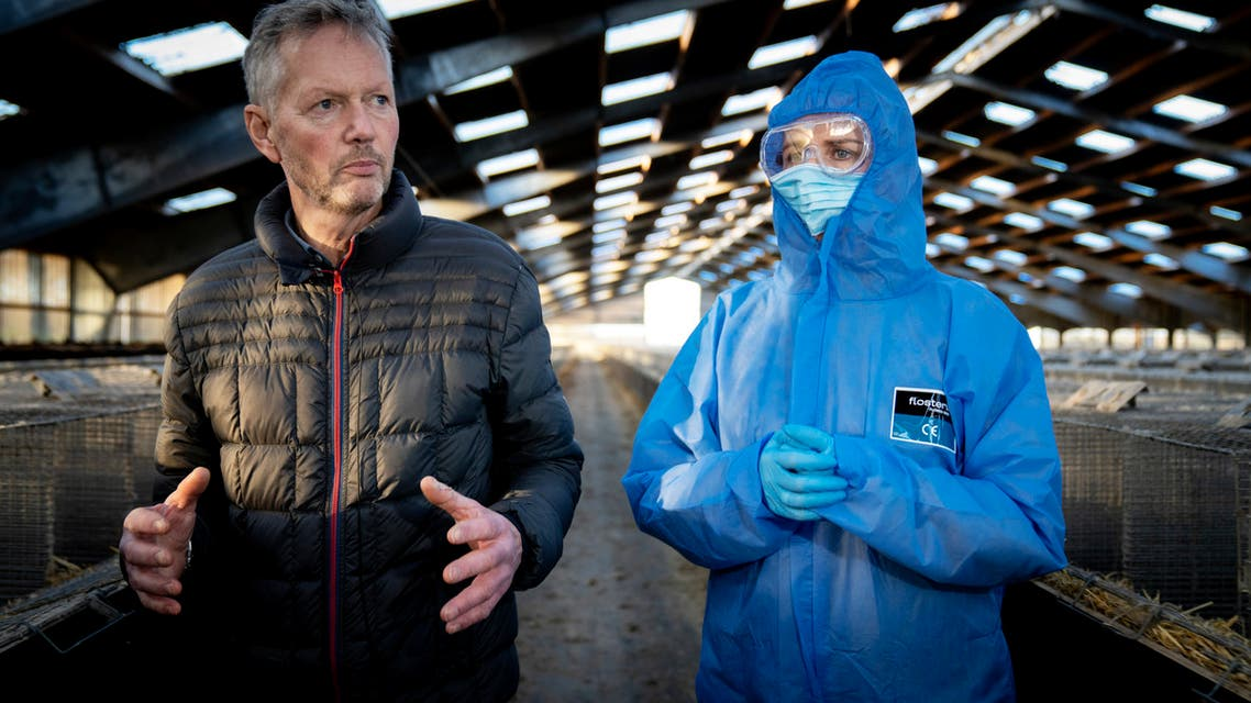 Denmark's Prime Minister Mette Frederiksen (R) and mink breeder Peter Hindbo visit the closed and empty farm near Kolding, Denmark. (AFP)
